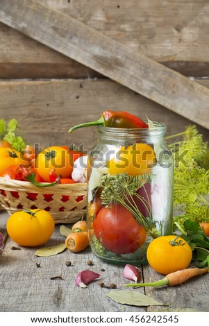 Tomatoes, herbs, garlic, glass jar - set for home canning. - stock photo