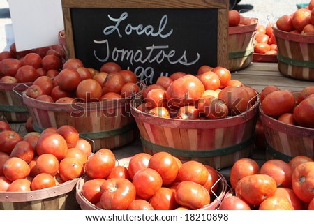 Tomatoes in baskets at the farm stand - stock photo