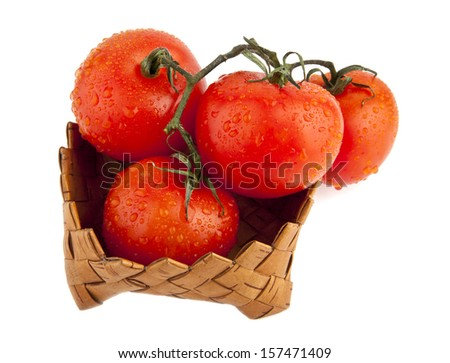 tomatoes in drops of water on a white background