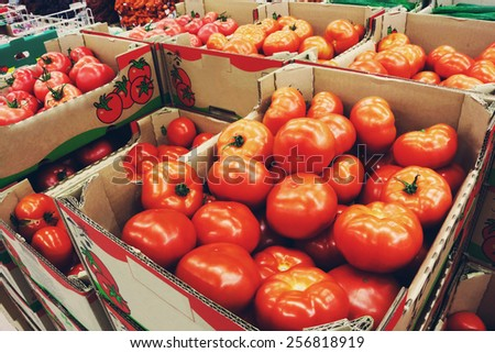 Tomatoes in the boxes at the food store - stock photo
