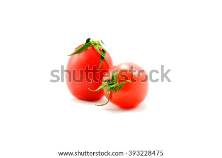 Tomatoes isolated on white background, Two red tomatoes isolated over white background. - stock photo