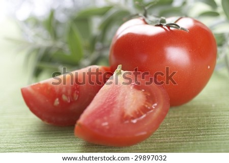 Tomatoes, object on a green background