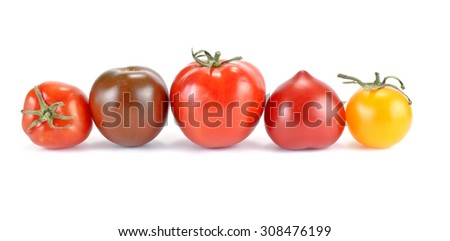 Tomatoes of different sorts isolated on a white background