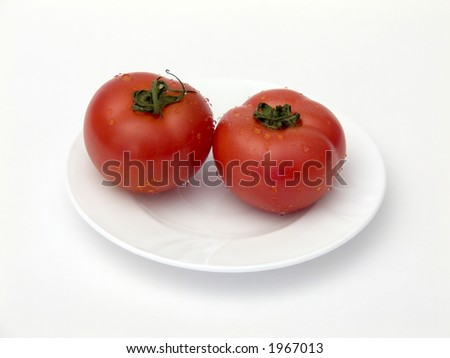 Tomatoes on a plate. If you download this image, please let me know how you want to use it. This information is for my private use only. Thank you.