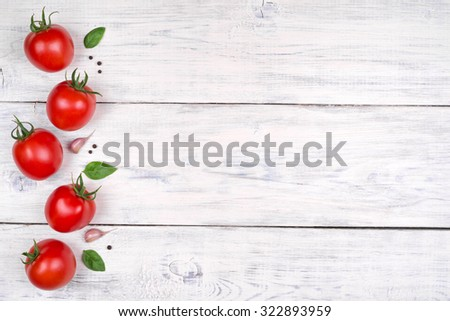 tomatoes on a white wooden table, pasta ingredients top view copy space - stock photo