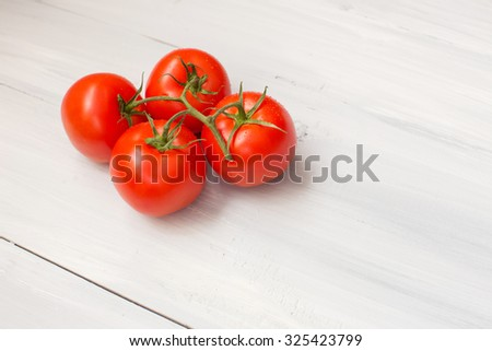 Tomatoes on a wooden background.