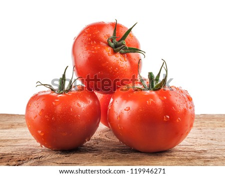 Tomatoes on a wooden background. Farmers Vegetable Market