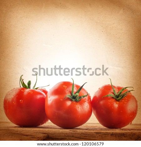 Tomatoes on the grunge yellow paper background. Farmers Vegetable Market - stock photo