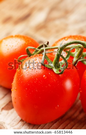 tomatoes on the wood board - stock photo