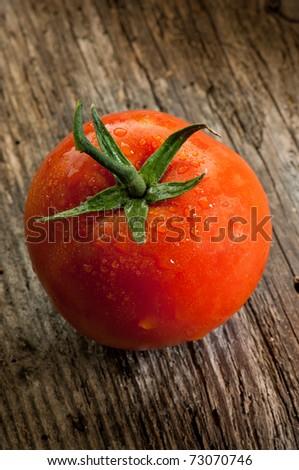 tomatoes on wood background - stock photo