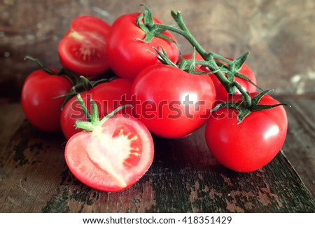 tomatoes on wooden background - stock photo