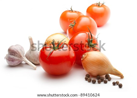Tomatoes, onions, pepper and garlic isolated on the white background