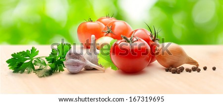 Tomatoes, onions, pepper, parsley and garlic on table