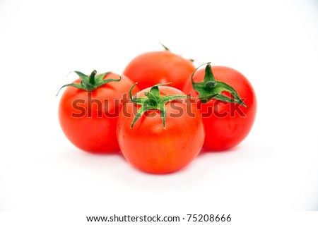 Tomatoes over white background