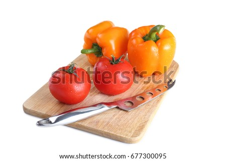 Tomatoes, pepper, knife on the board isolated on white background