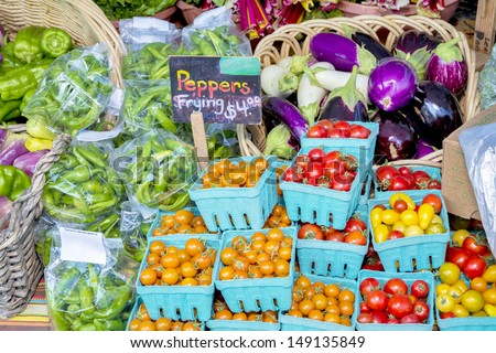 Tomatoes, peppersm and eggplant at a farmers market - stock photo