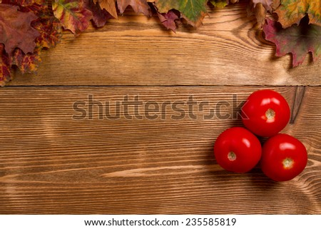 Tomatoes red on wooden table - stock photo