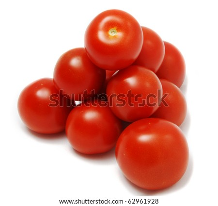 Tomatoes stacked like they would be at a super market.