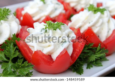 Tomatoes stuffed with cream cheese - stock photo