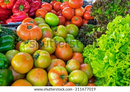 Tomatoes, sweet pepper and salad - stock photo