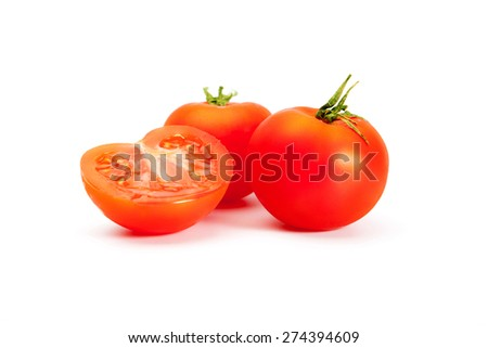 Tomatoes. Two mouth-watering delicious whole tomato and a half on a white background.  - stock photo