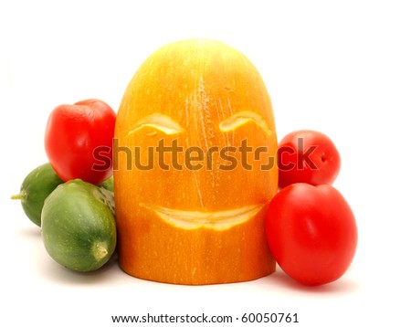 Tomatoes, vegetable marrow and cucumbers on a white background