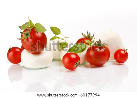 tomatoes with mozzarella and basil - stock photo