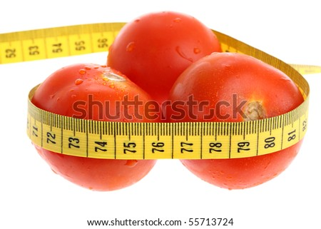 Tomatoes with yellow measuring tape as losing weight concept isolated on white - stock photo