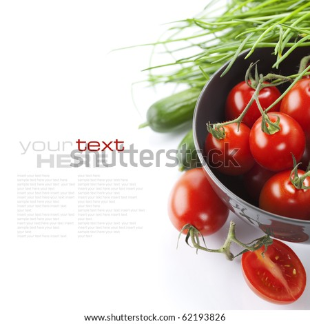 Tomatos, chives and cucumbers on white background (with sample text) - stock photo
