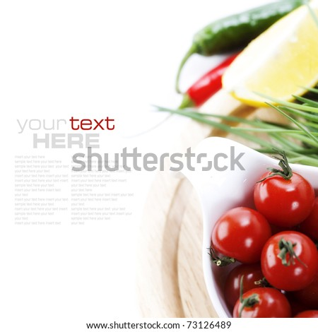 Tomatos, chives, peppers and lemon on white background. With sample text