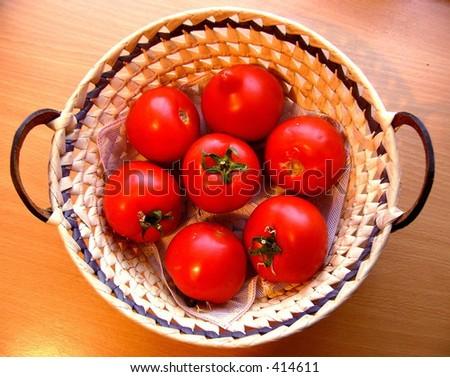 Tomatos in basket - stock photo