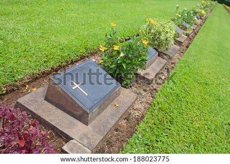 tomb in grass garden - stock photo