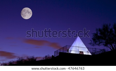 Tomb of Governor Hunt (Arizona's First Governor) in Tempe and Phoenix Arizona's Papago Park photographed at night with the moon. - stock photo