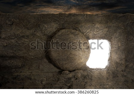 Tomb of Jesus with light coming out of opening - stock photo