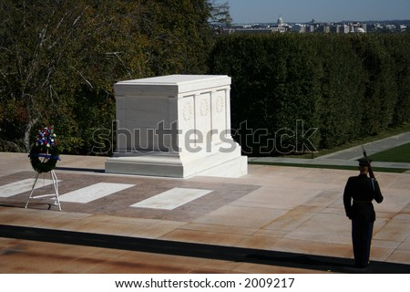 Tomb of the unknown soldier Arlington cemetery with honor guard standing - stock photo