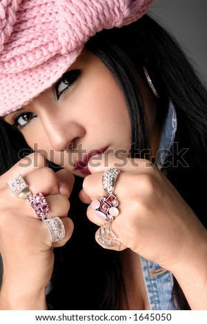 Tomboy with bling.   Focus is on the rings - stock photo