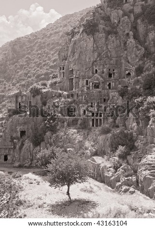 Tombs carved into the rocks in the town of Demre Turkey. Sepia