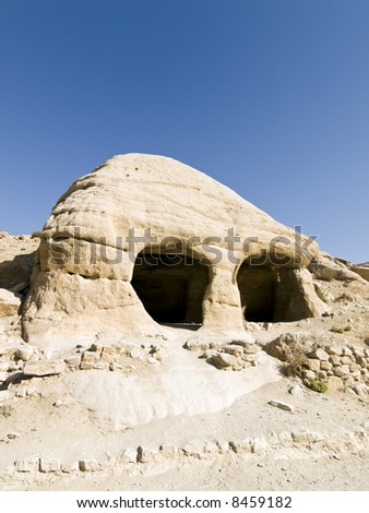 Tombs in Petra (Al Khazneh - Nabataeans capital city) , Jordan. Made by digging a holes in the rocks. Roman Empire period. - stock photo