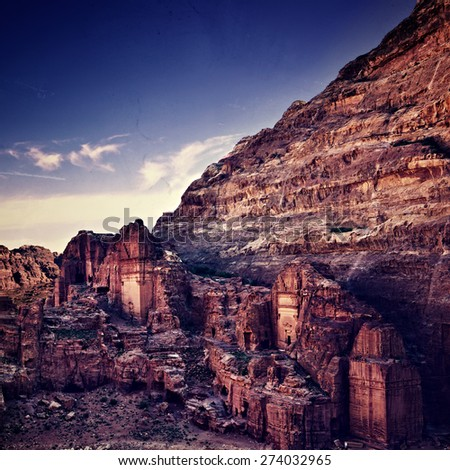 Tombs in Petra in Jordan at sunset time. Filtered image, vintage effect applied - stock photo
