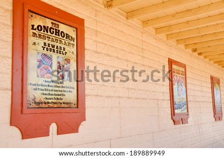 TOMBSTONE, ARIZONA - APRIL 18: Street scene in a western town on April 18, 2011 in Tombstone, Arizona. OK Corral gunfight  occurred in this village. - stock photo