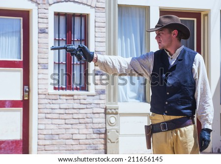 TOMBSTONE , ARIZONA - AUG 09 : Actor takes part  in the Re-enactment of the OK Corral gunfight in Tombstone , Arizona on August 09 2014.  - stock photo