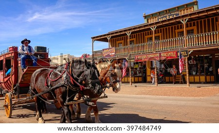 TOMBSTONE, ARIZONA - MARCH 20: A stagecoach filled with tourists travels the historic streets of Tombstone, Arizona on March 20th, 2016. - stock photo