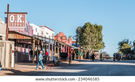 TOMBSTONE, ARIZONA - NOV 15, 2014: Looking down Allen Street in historic Tombstone, Arizona with cowboys and tourists. - stock photo