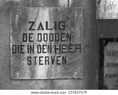 tombstone with a dutch phrase in it. Free translated it means: Blessed are the dead which died in the name of the Lord - stock photo