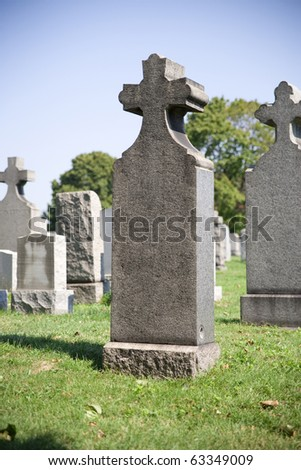 tombstone with cross in the cemetery - stock photo