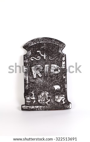 Tombstone with skull isolated on white background, - stock photo
