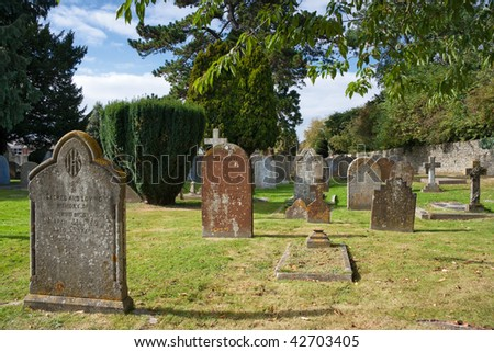 Tombstones at an old graveyard in Bicester. England - stock photo