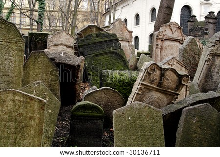 Tombstones at the old Jewish cemetery in Prague - stock photo