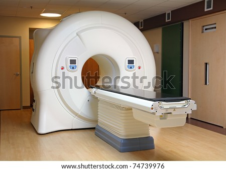 tomography cancer treatment machine in hospital - stock photo