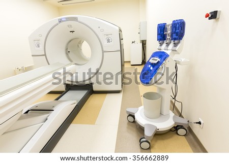 Tomography cancer treatment scanner in a clinic room.